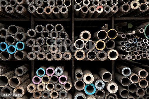 istock Close up various shape metal profiles and tubes on shely 1062168498