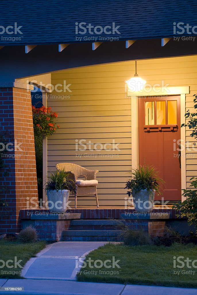 Close up , vertical, evening glow bungalow with porch and pathway royalty-free stock photo
