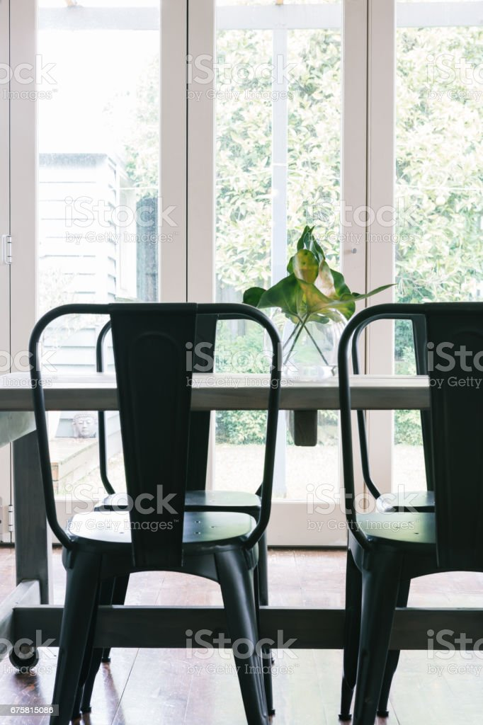 Close up vertical of black metal industrial styled dining table stock photo