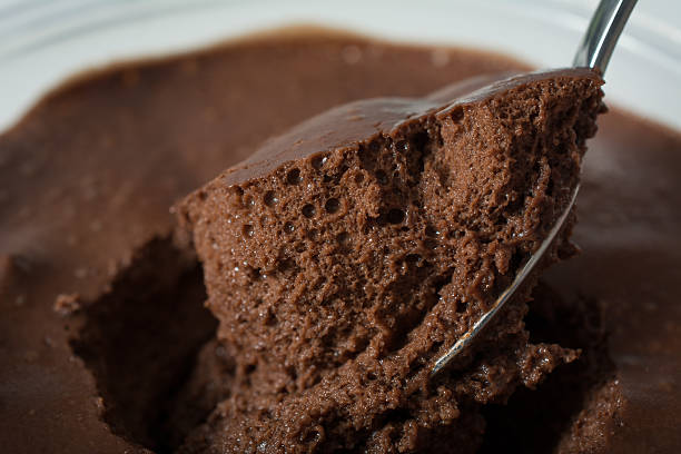 Close up Very dark chocolate mousse on a spoon stock photo