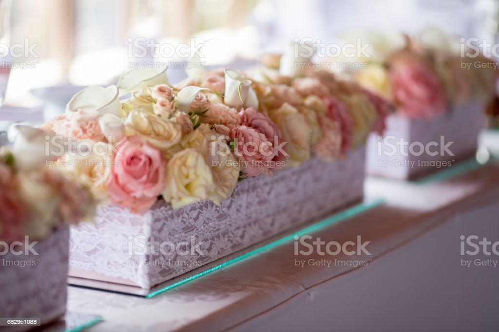 Close up view at flower decorations for holidays and wedding dinner royalty-free stock photo