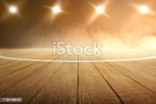 517960203 istock photo Close up view of a basketball court with wooden floor and spotlights 1194196191