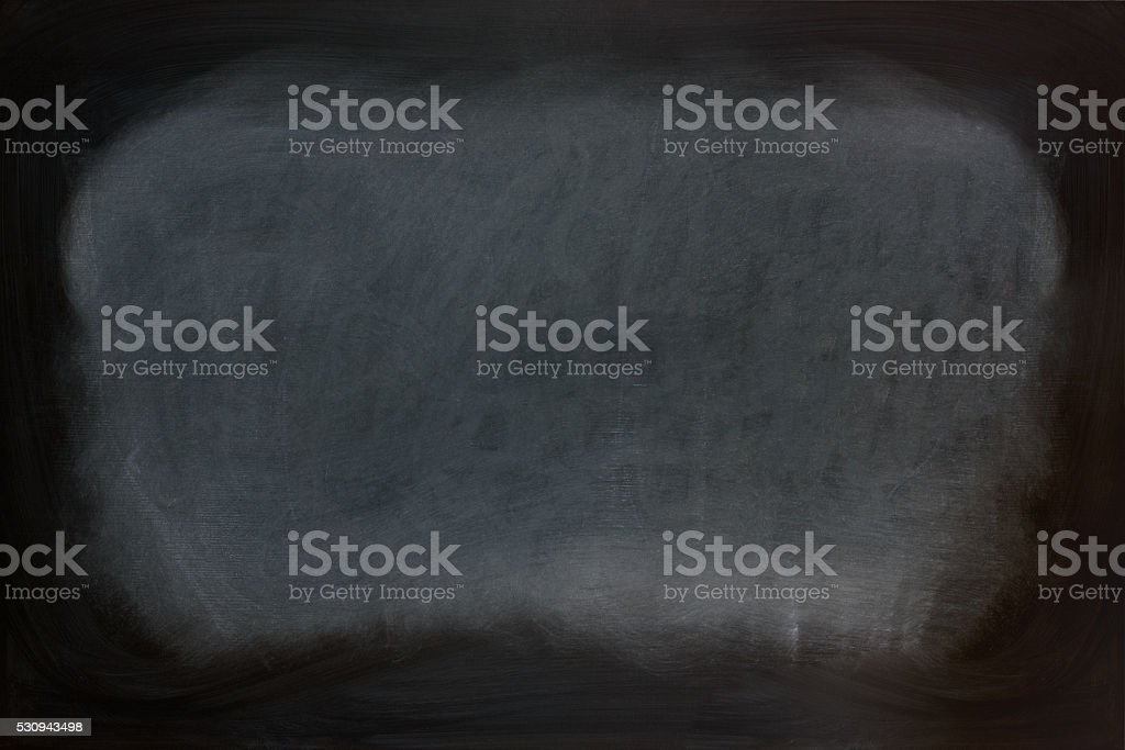 Close up view of a black dirty chalkboard. stock photo