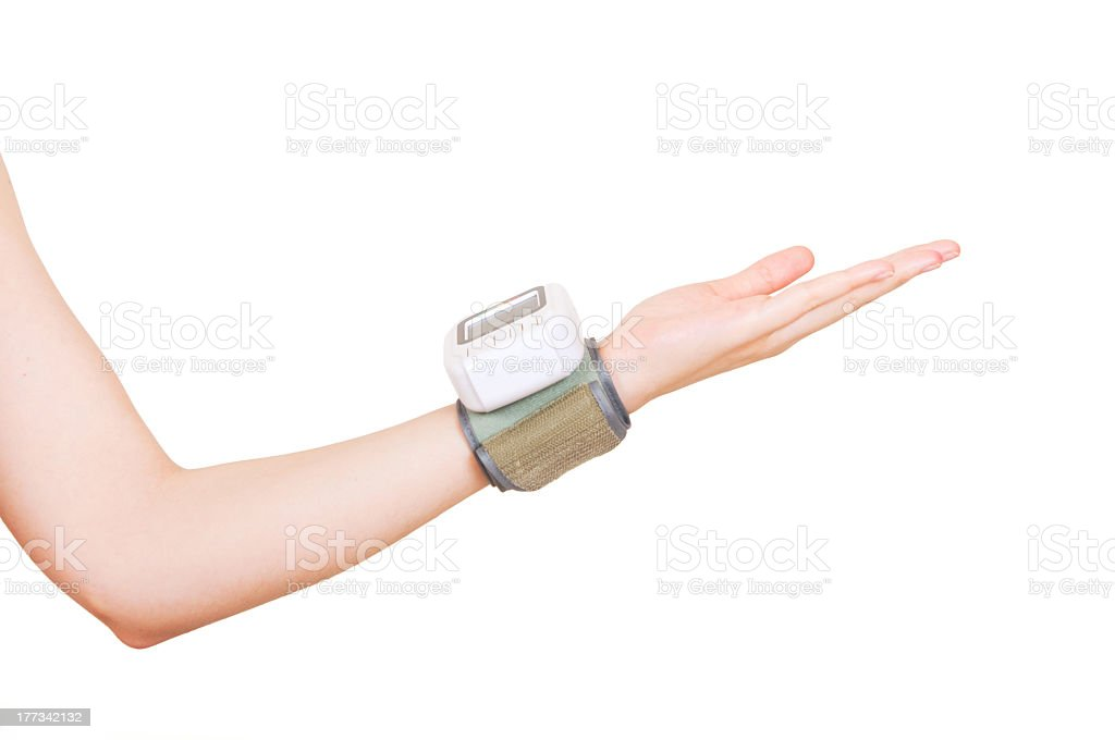 Close up view of a blood pressure monito on hand royalty-free stock photo