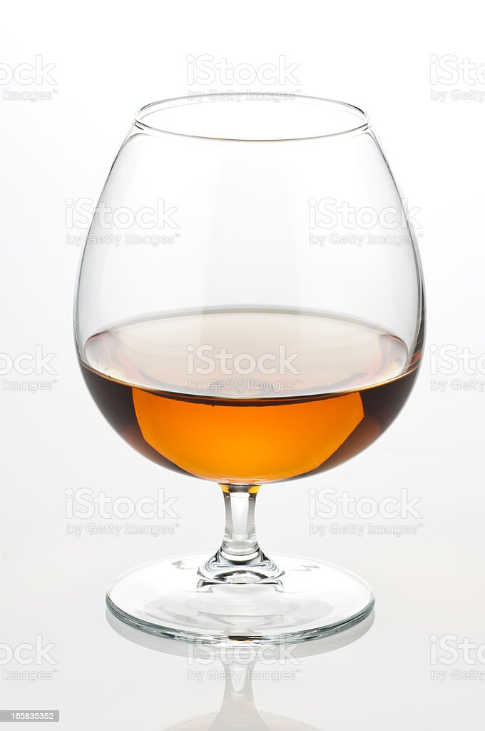 Close up view of a cognac glass or snifter half full stock photo