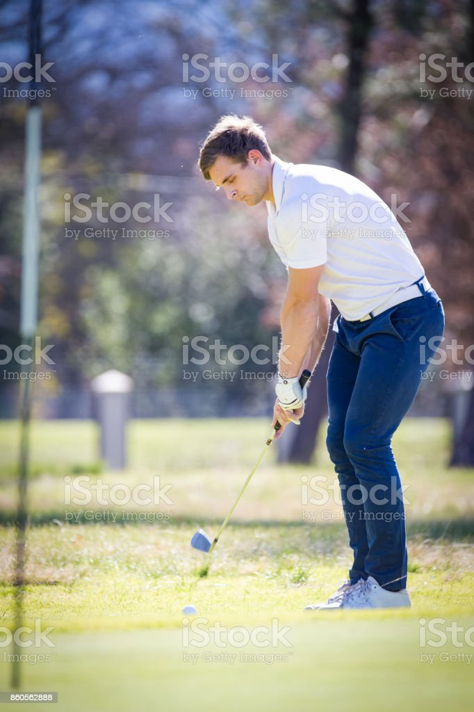 Close up view of  a golfer playing a chip shot on a golf course in South Africa stock photo