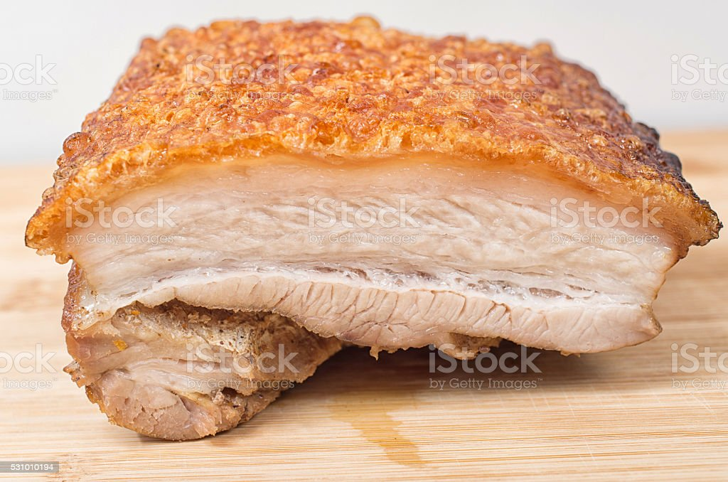 Close up view of a piece of roasted pork belly stock photo
