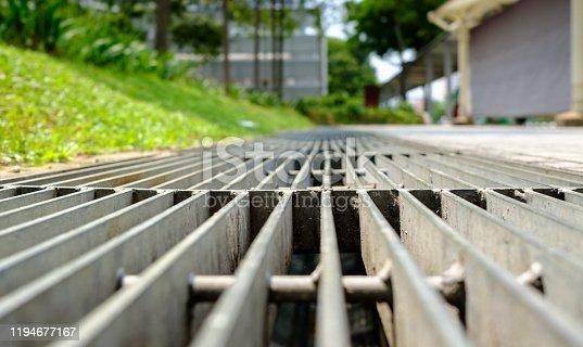 close up of a sidewalk drainage gate