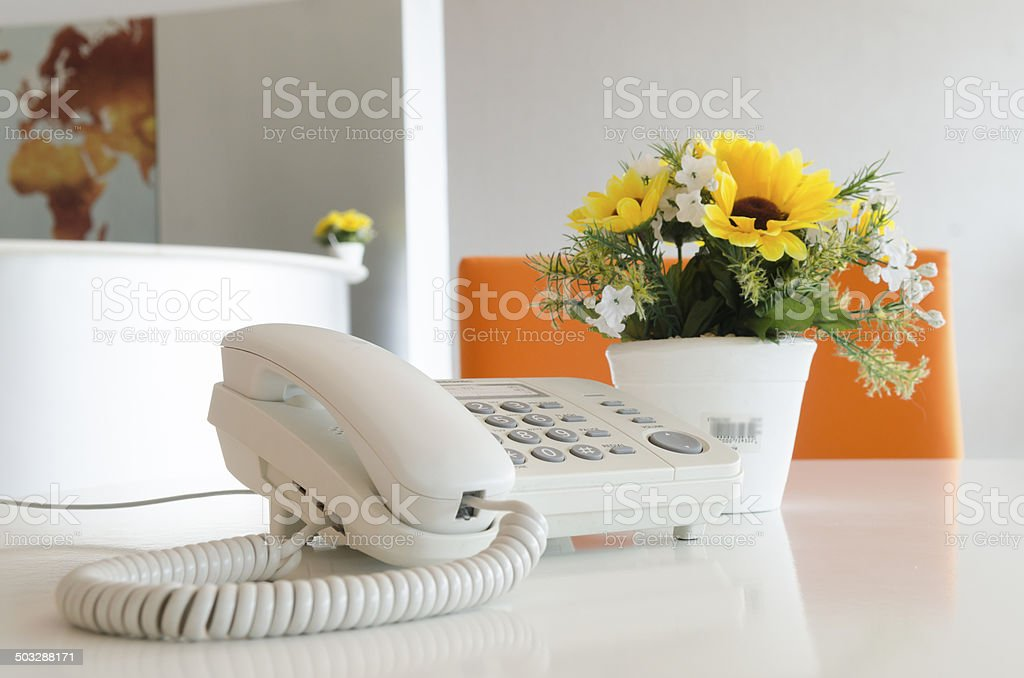 Close up view of a work desk interior with telephone stock photo