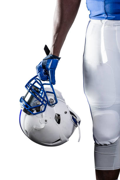 Close up view of an American Football Player holding his helmet stock photo