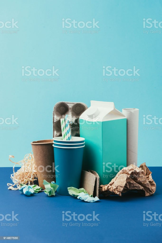 close up view of arranged cardboard and paper disposable garbage on...