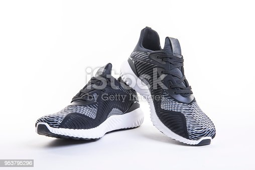 Close up view of black sport running and fitness shoe, sneakers or trainers isolated on a white background.