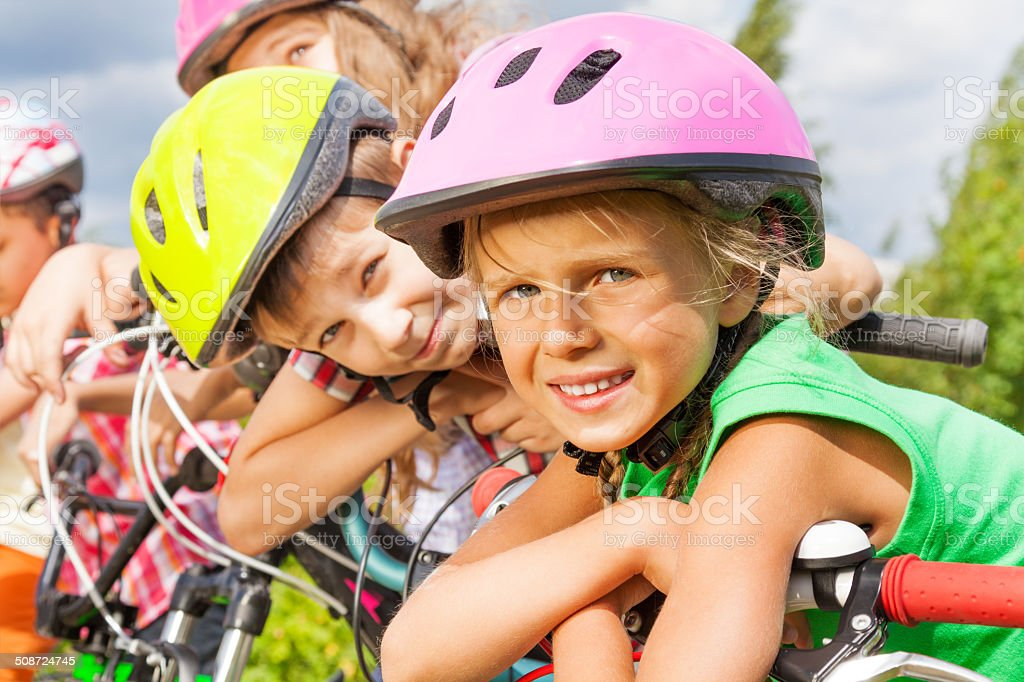 Close up view of blond girl and boy in helmet stock photo