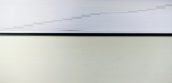 Close up view of book section with grey increasing register