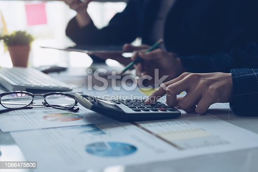 istock Close up view of bookkeeper or financial inspector hands making report, calculating or checking balance. Home finances, investment, economy, saving money or insurance concept 1066475800