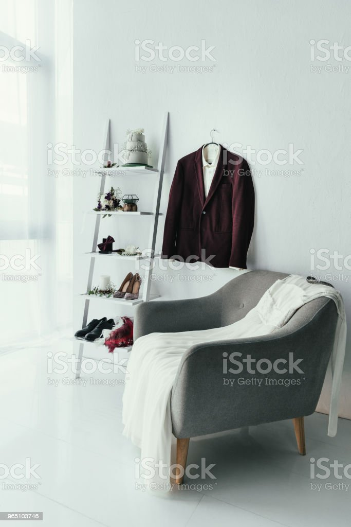 close up view of bridal and grooms clothing and accessories for rustic wedding in room royalty-free stock photo