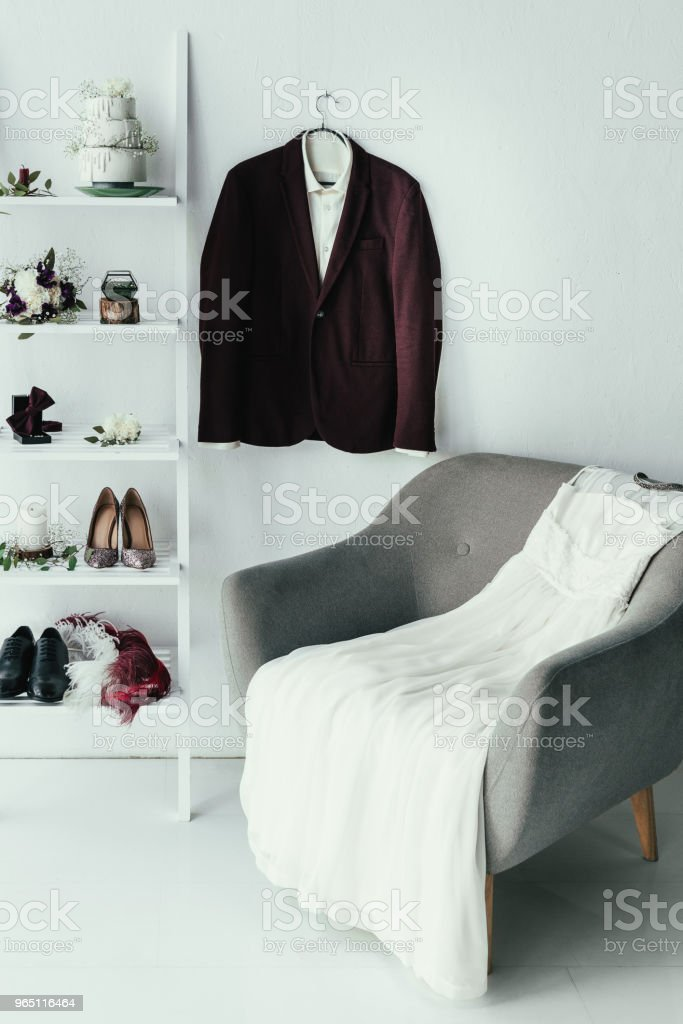 close up view of bridal and grooms clothing and accessories for rustic wedding in room zbiór zdjęć royalty-free
