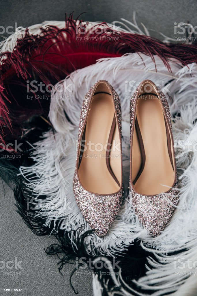 close up view of bridal shoes and decorative feathers for rustic wedding on armchair zbiór zdjęć royalty-free