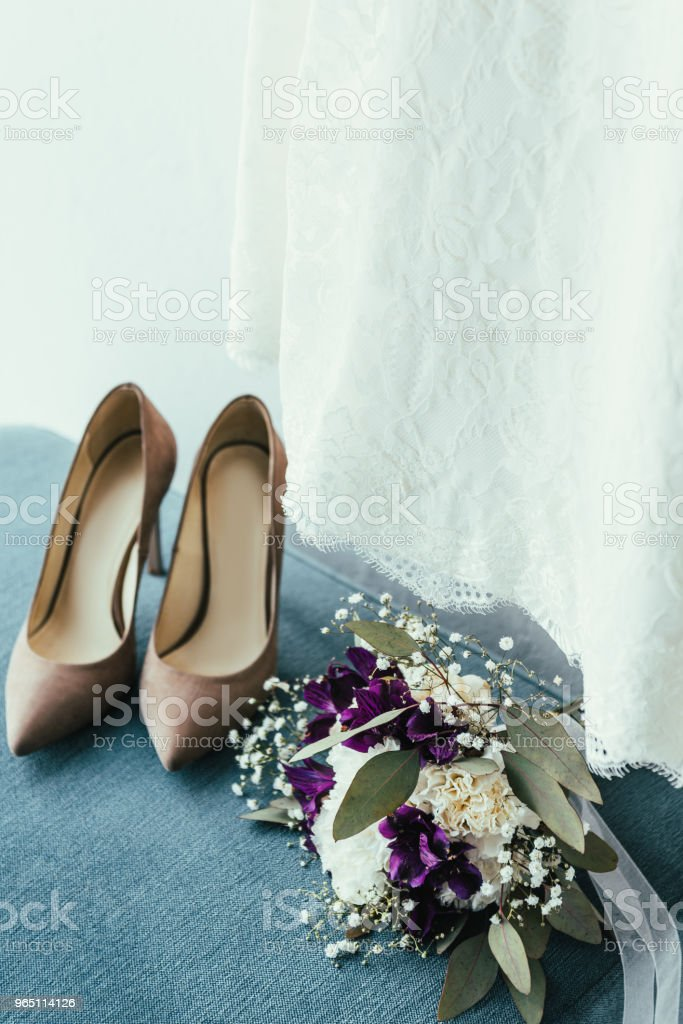close up view of bridal shoes, wedding bouquet and dress for rustic wedding royalty-free stock photo