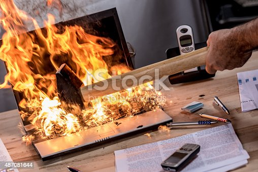 593328060 istock photo Close up view of burning laptop 487081644