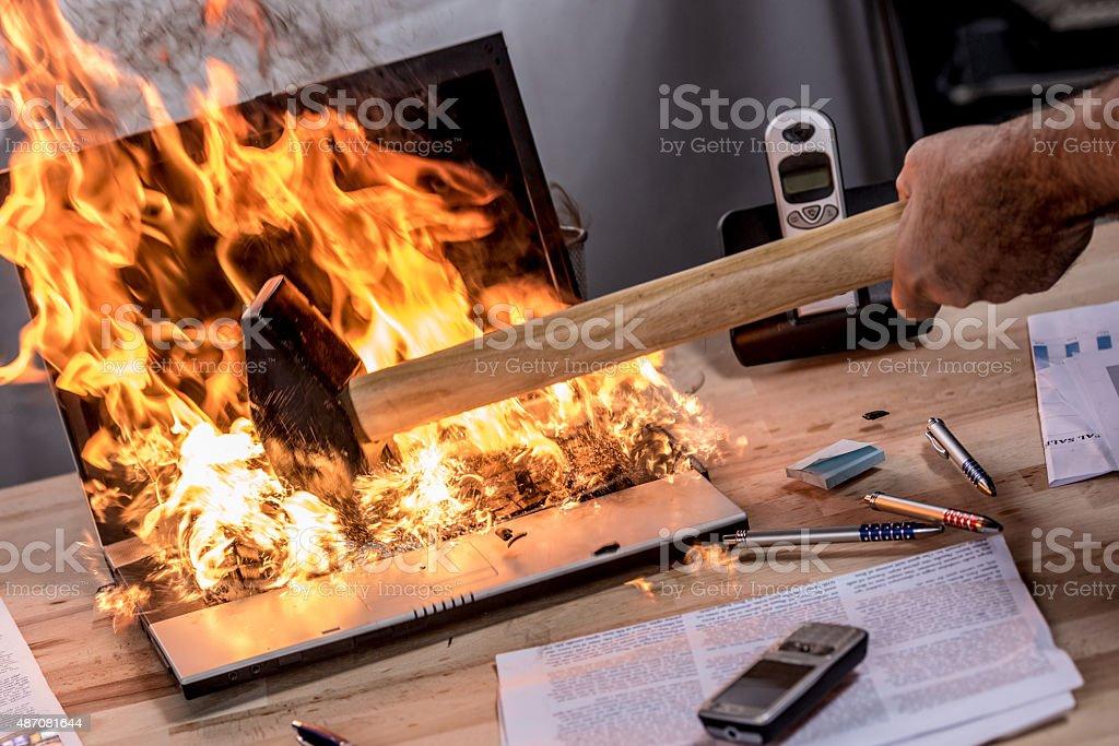 Close up view of burning laptop stock photo