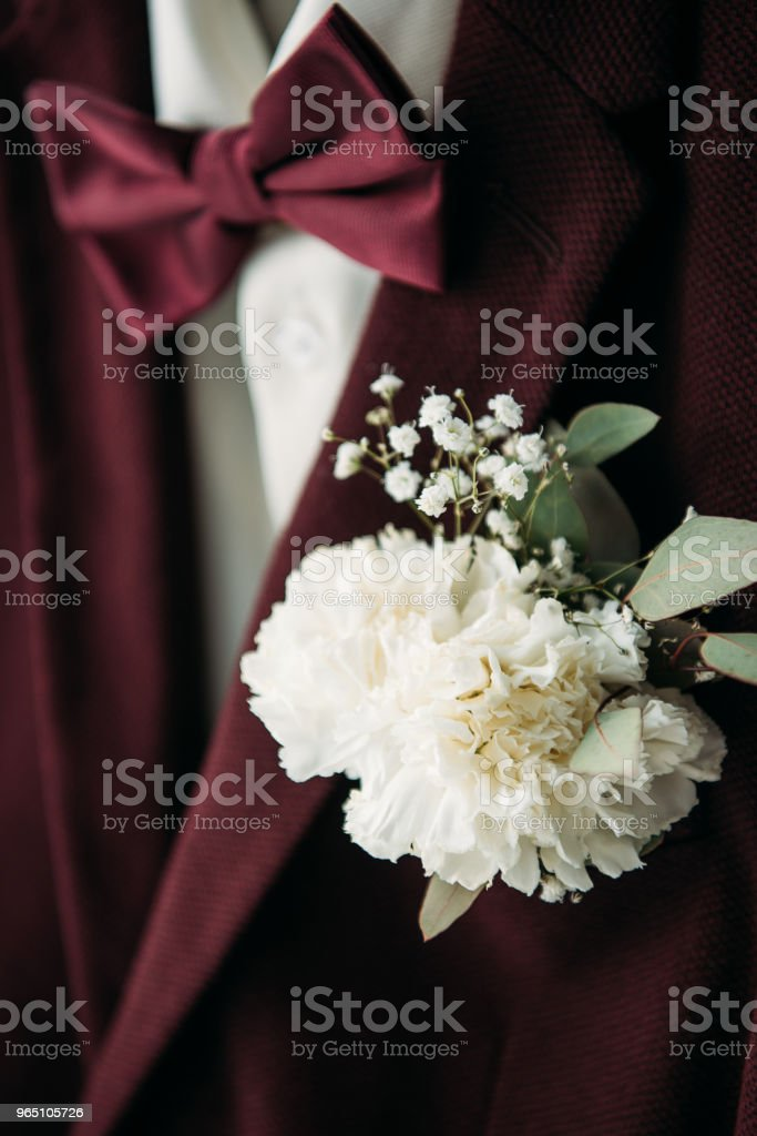 close up view of buttonhole and grooms suit with bow tie for rustic wedding zbiór zdjęć royalty-free