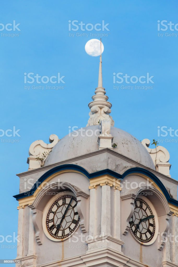 Close up view of clock tower with blue sky in George Town Penang stock photo