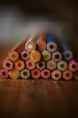 Colored pencils arranged in a row on a white background