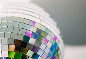 Close up view of colorful disco ball with multicolored reflections. Preparing for a fun night party or holiday at home.
