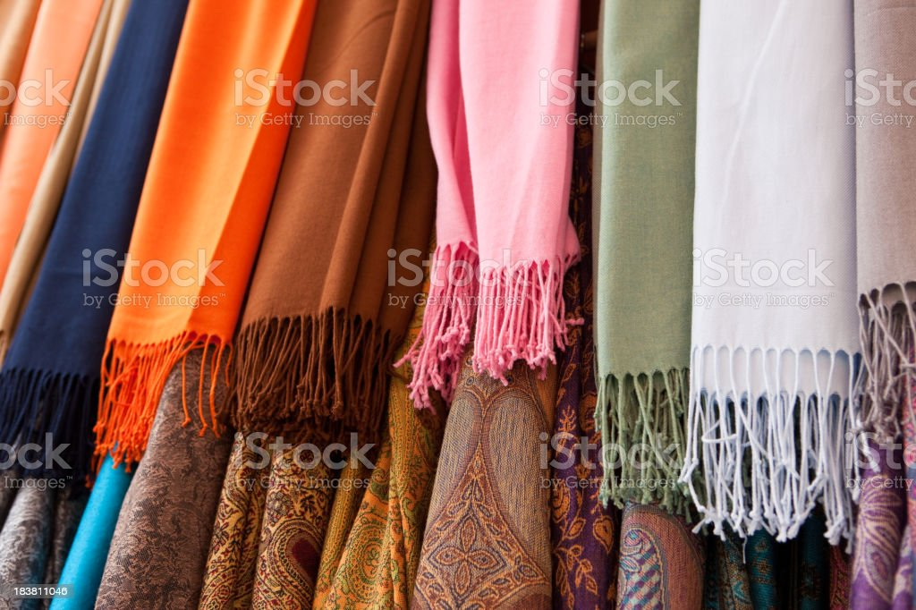 Close up view of colorful pashmina shawls hanging in 2 rows  royalty-free stock photo