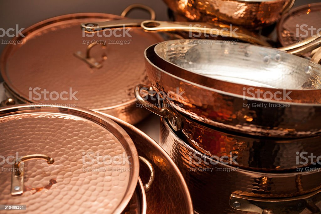 Close up view of copper cooking pots stock photo