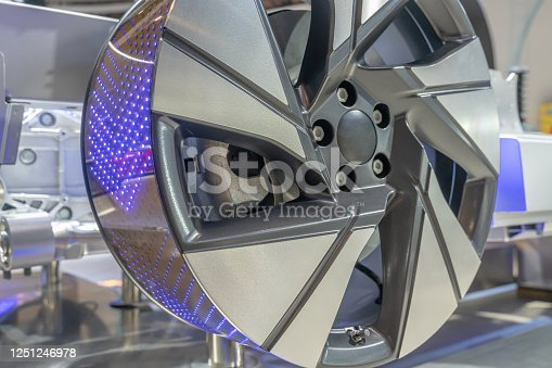 907671144 istock photo close up view of detailed electric car wheel hub in factory. 1251246978