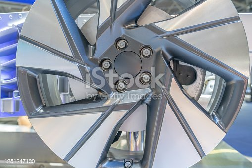 907671144 istock photo close up view of detailed electric car wheel hub in factory. 1251247130