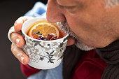 herbal tea concept with an senior man