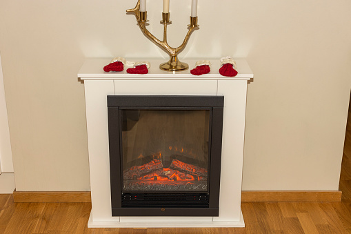 Close up view of electric fireplace isolated on white wall background.