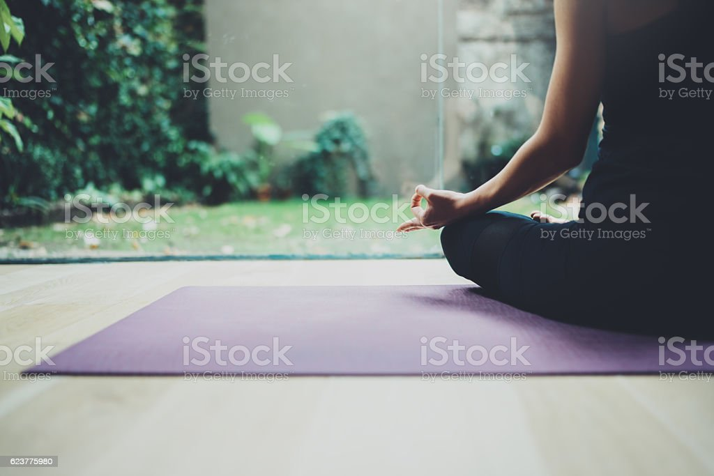 Close up view of female in lotuse pose.Young woman stock photo