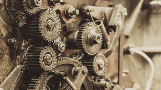 close up view of gears from old mechanism - low contrast stock pictures, royalty-free photos & images