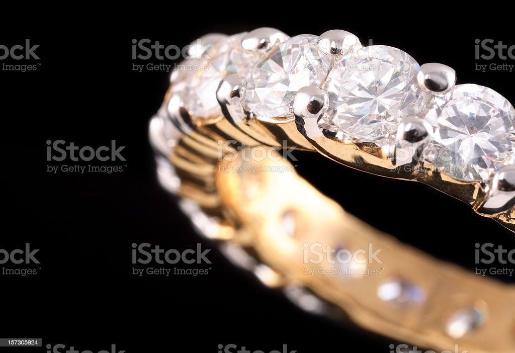 Close up view of gold ring with diamonds stock photo
