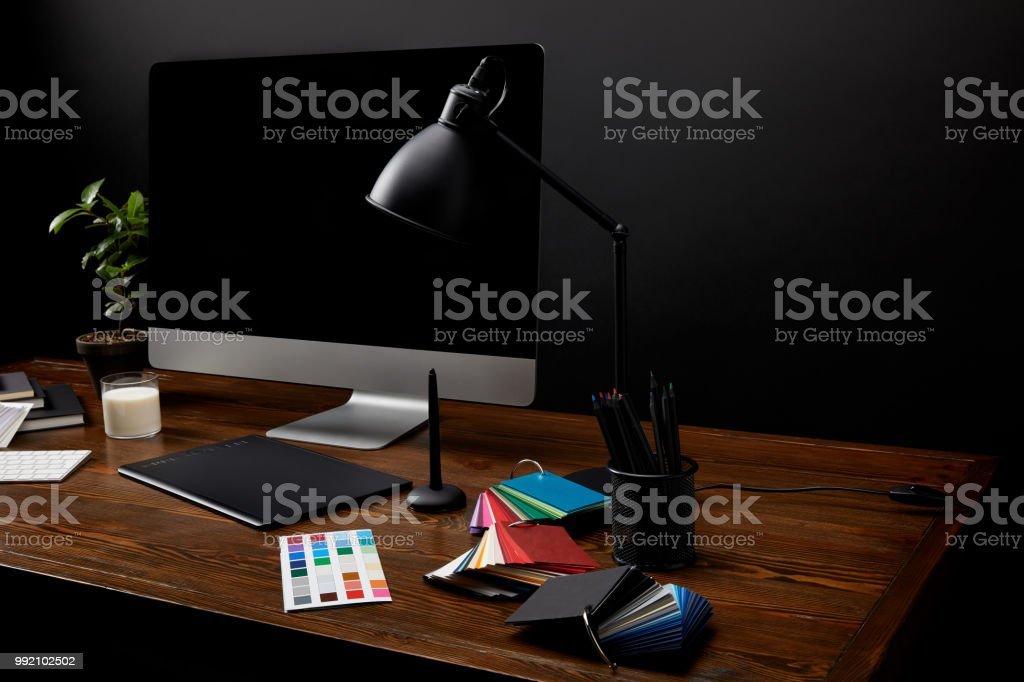 close up view of graphic designer workplace with colorful pallet,...