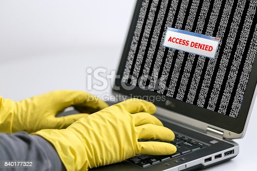 istock Close up View of Hands of Hacker working on Laptop 840177322