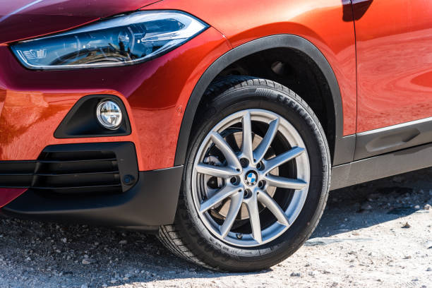 Close up view of headlight and tire of BMW X2 stock photo