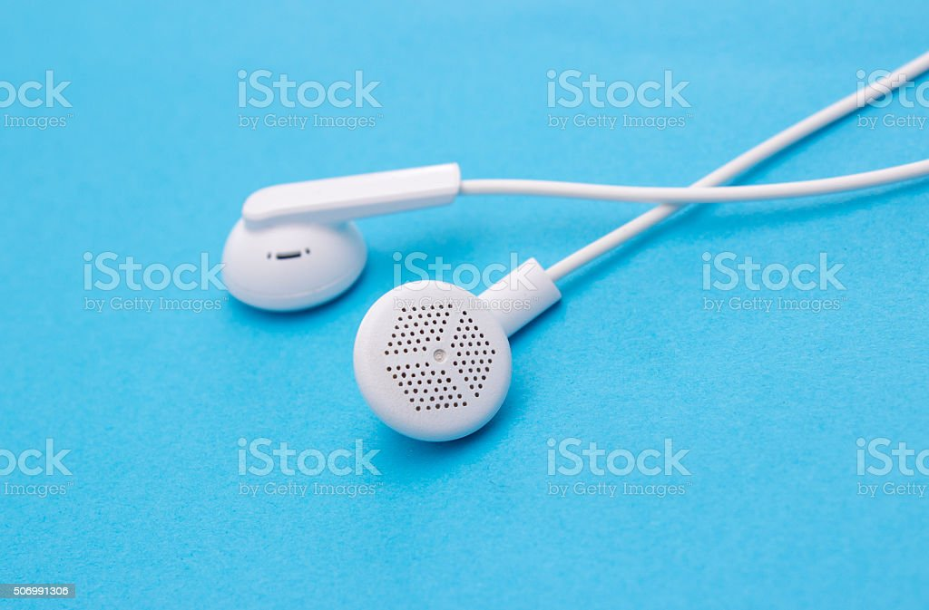 Close up view of headphones isolated on blue stock photo