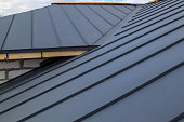 istock close up view of  house under construction with grey folding roof on waterproofing layer 1292399149