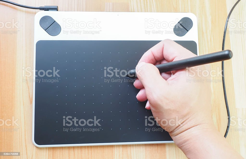close up view of man working with tablet stock photo