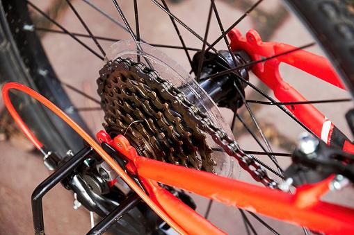 Close Up view of metallic bike gear on the rear wheel of a mountain bike