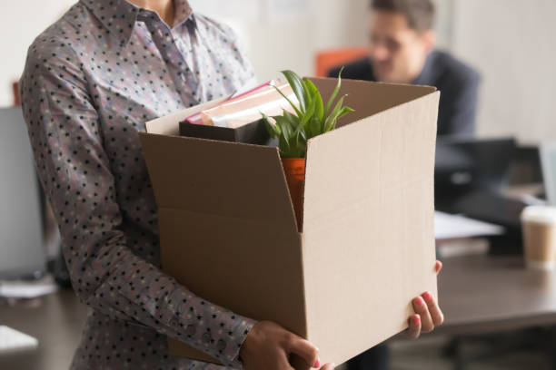 Close up view of new female employee intern holding box Close up view of new female employee intern holding cardboard box with belongings start finish job in company office, busnesswoman newcomer worker get hired fired on first last day at work concept downsizing unemployment stock pictures, royalty-free photos & images