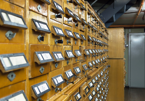 668340340 istock photo close up view of old wooden  file cabinets with handles 939490892