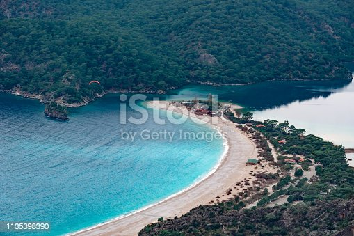 istock Close up view of Oludeniz Beach and bay with Paradliding, Mugla, Turkey.  Aerial Photo from Lycian way. Summer and holiday concept. 1135398390