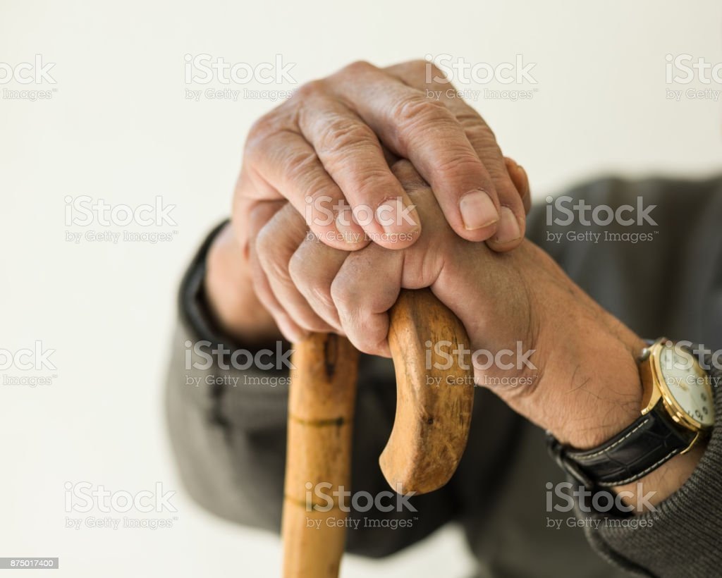 Close Up View Of Senior Adult man Hand on Walking Cane stock photo