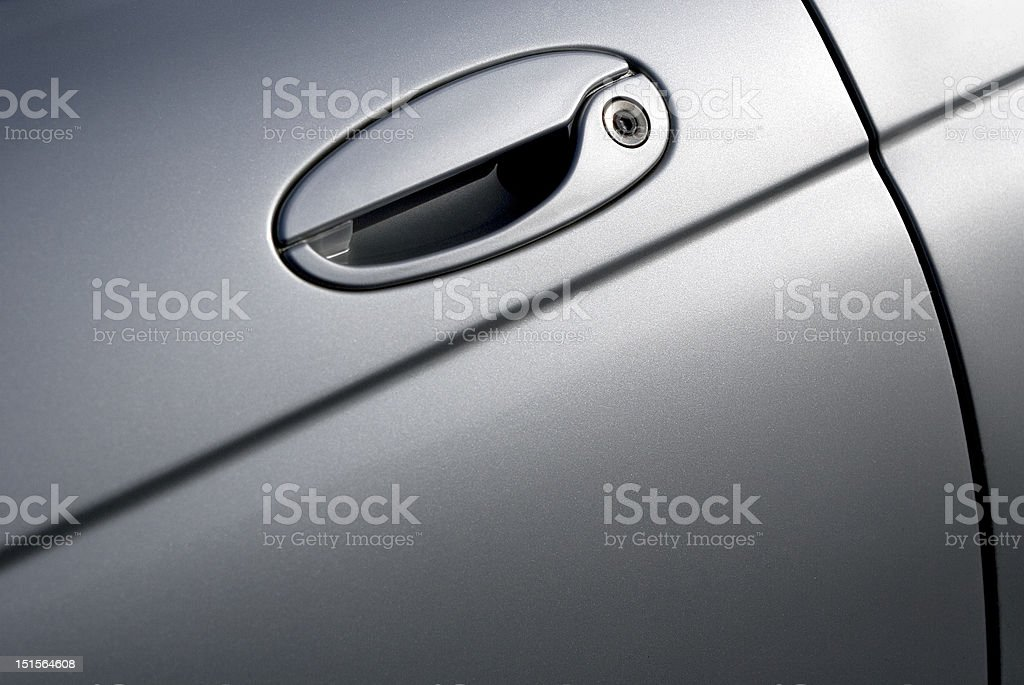 Close up view of silver car door royalty-free stock photo